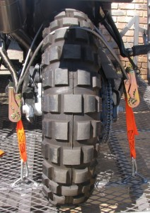 Rear wheel tie down bracket