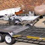 Triple quad rear loader